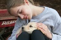 Resized petting a dog1.jpg?ixlib=rails 2.1