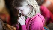 Small girl praying.jpg?ixlib=rails 2.1