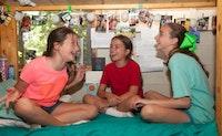 Three girls laughing in bunk.jpg?ixlib=rails 2.1