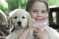 Holding a puppy1.jpg?ixlib=rails 2.1
