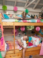 Campers visiting in decorated bunks.jpg?ixlib=rails 2.1