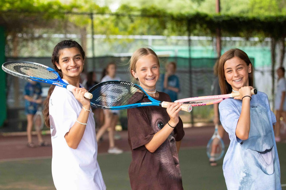 Three campers with tennis rackets.jpg?ixlib=rails 2.1