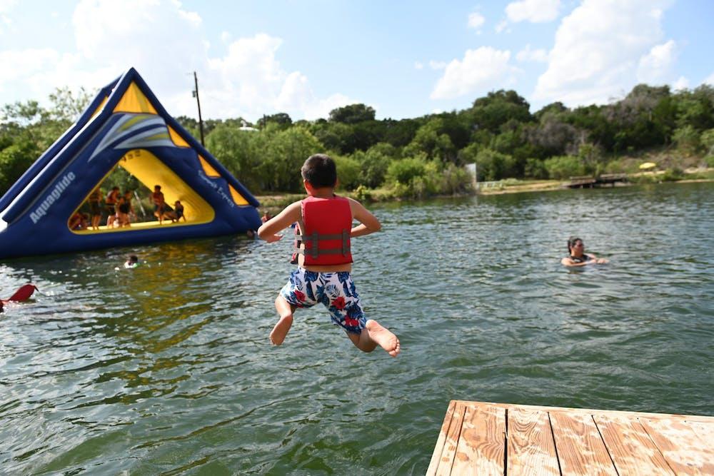 Boy leaping into the lake.jpg?ixlib=rails 2.1