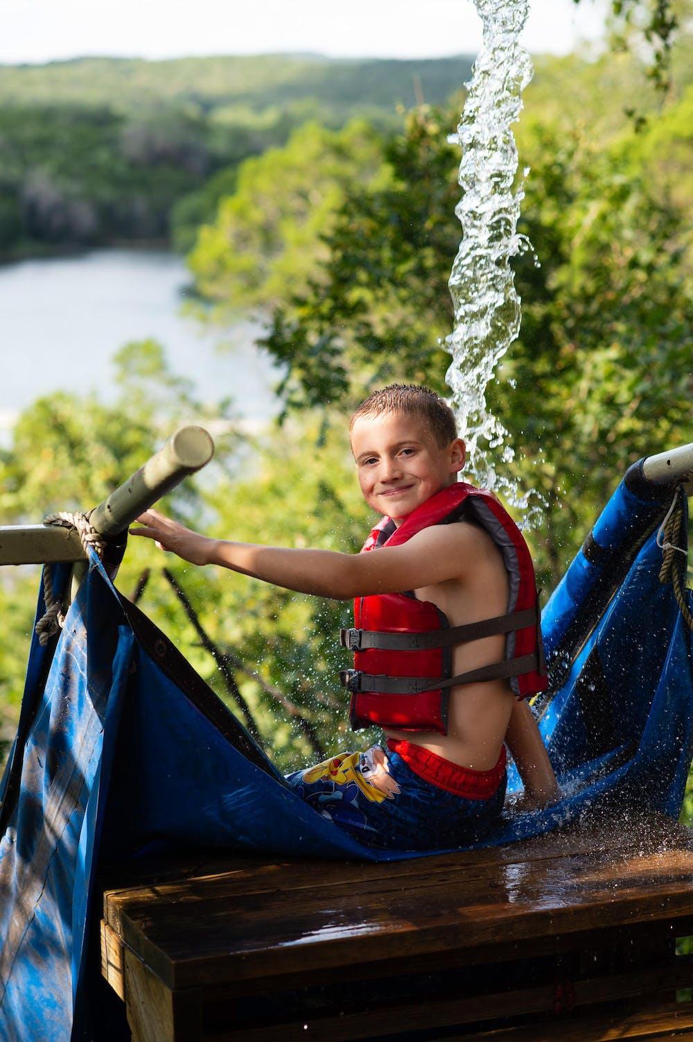 Smiling boy on the waterslide.jpg?ixlib=rails 2.1