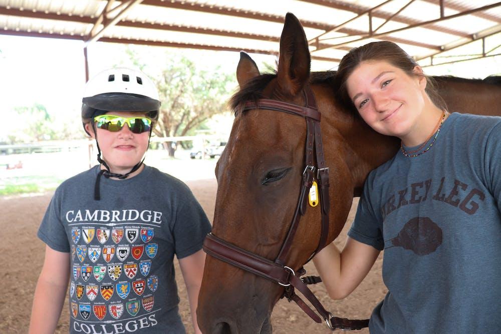 Horseback riding counselor and camper.jpg?ixlib=rails 2.1