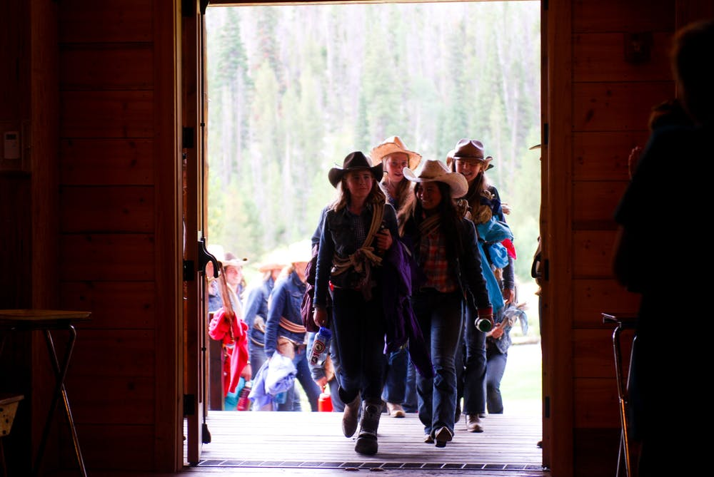 Wranglers enter the dining hall.jpg?ixlib=rails 2.1