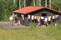 Teton valley ranch camp craftshop exterior.jpg?ixlib=rails 2.1