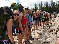 Girls on a backpack trip in the wilderness.jpg?ixlib=rails 2.1