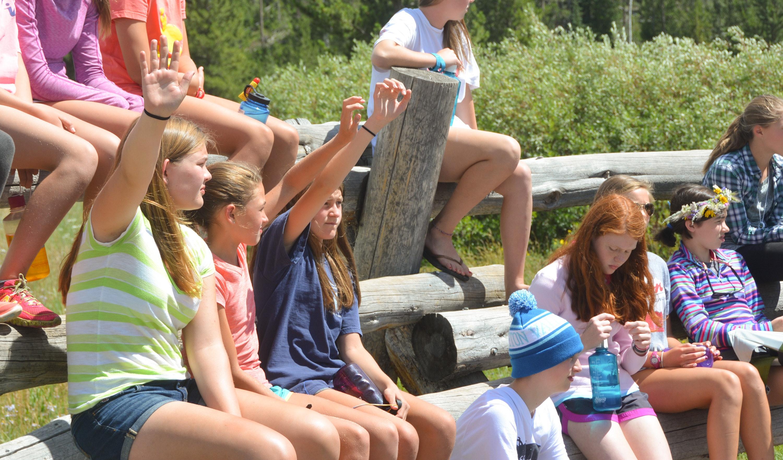Raising hands at the campfire ring.jpg?ixlib=rails 2.1