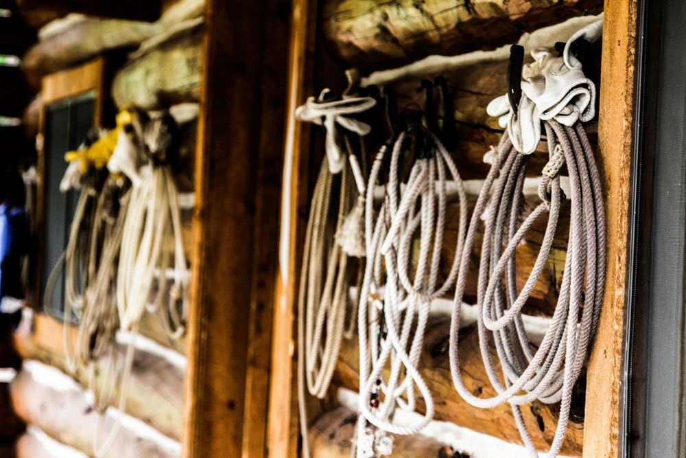 Rodeo lariats hung on the lodge.jpg?ixlib=rails 2.1