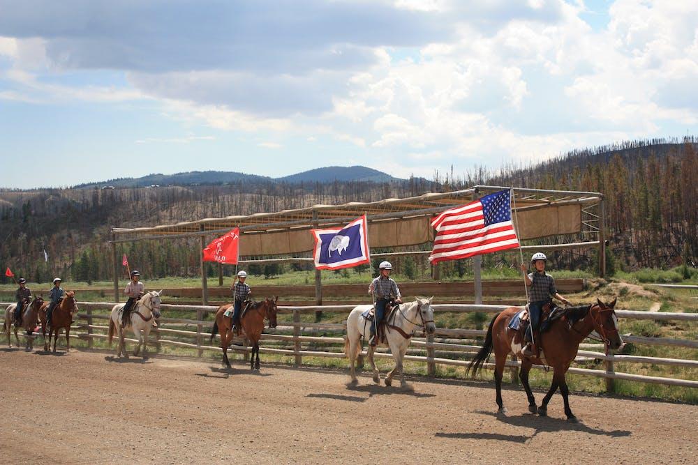 Horseback riding parade on the rodeo field.jpg?ixlib=rails 2.1