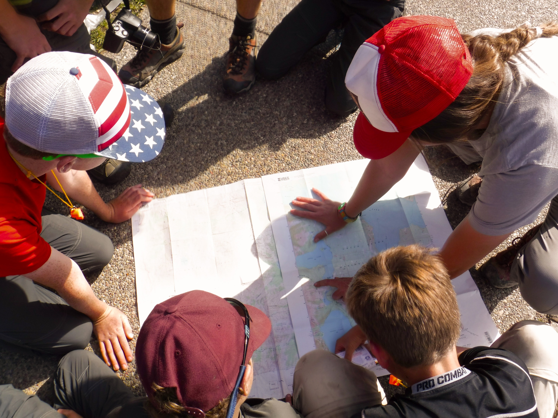 Staff and campers study a map.jpg?ixlib=rails 2.1