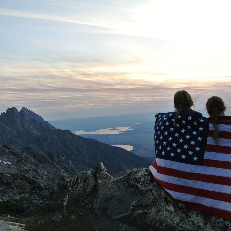Two girls summit the mountain with a flag.jpg?ixlib=rails 2.1