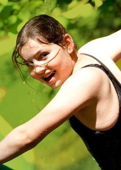 Girl on waterslide on green.jpg?ixlib=rails 2.1