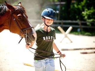 Leading a horse at keystone summer camp for girls.jpg?ixlib=rails 2.1