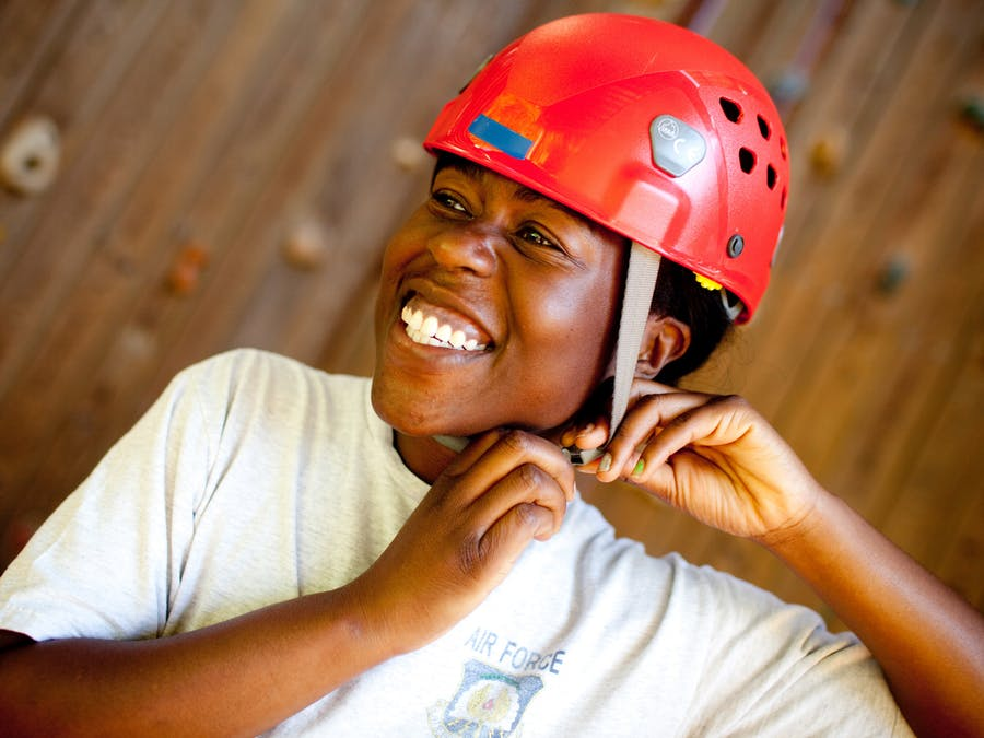 Smiles at the climbing wall at keystone camp for girls.jpg?ixlib=rails 2.1