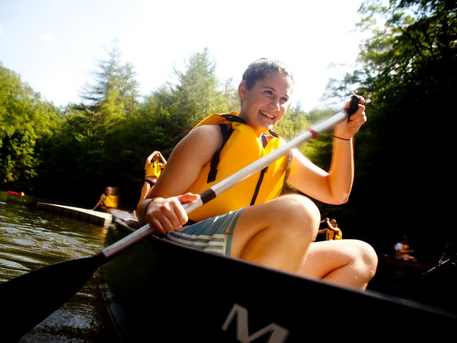 Smiling and paddling at keystone camp for girls.jpg?ixlib=rails 2.1