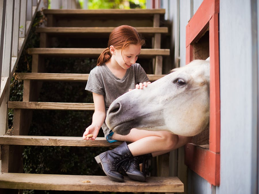Petting a horse at keystone camp for girls.jpg?ixlib=rails 2.1