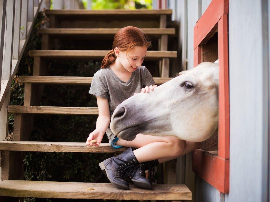 Petting a horse at keystone camp for girls.jpg?ixlib=rails 2.1