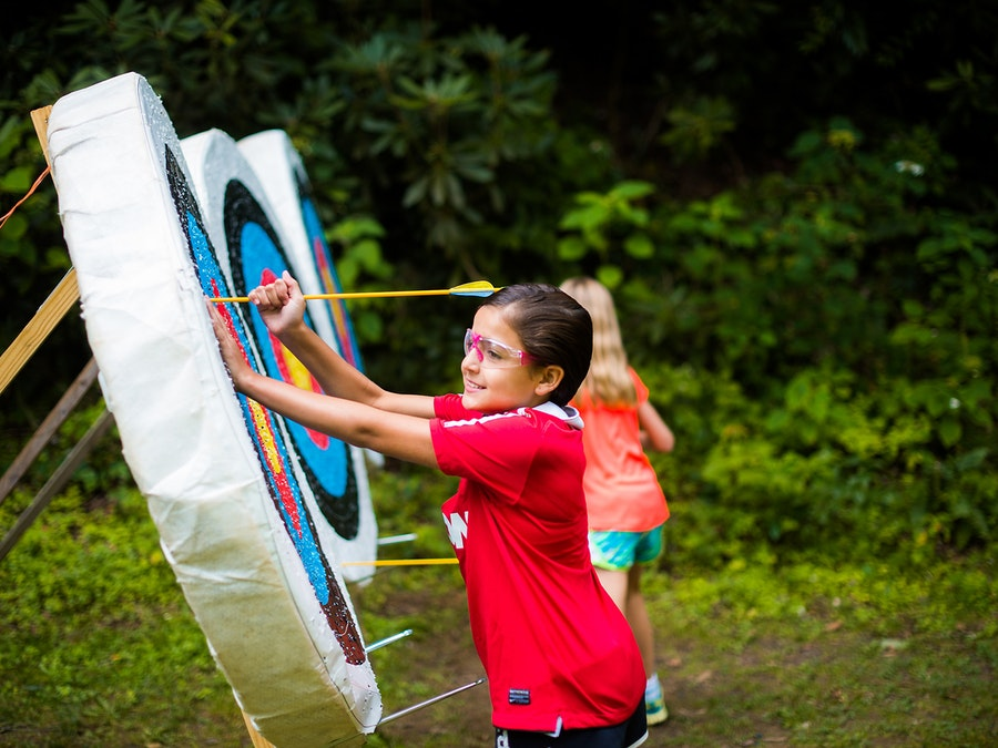 Pulling arrows out of targets at keystone camp for girls.jpg?ixlib=rails 2.1