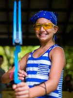 Smiling with a bow at keystone camp for girls.jpg?ixlib=rails 2.1