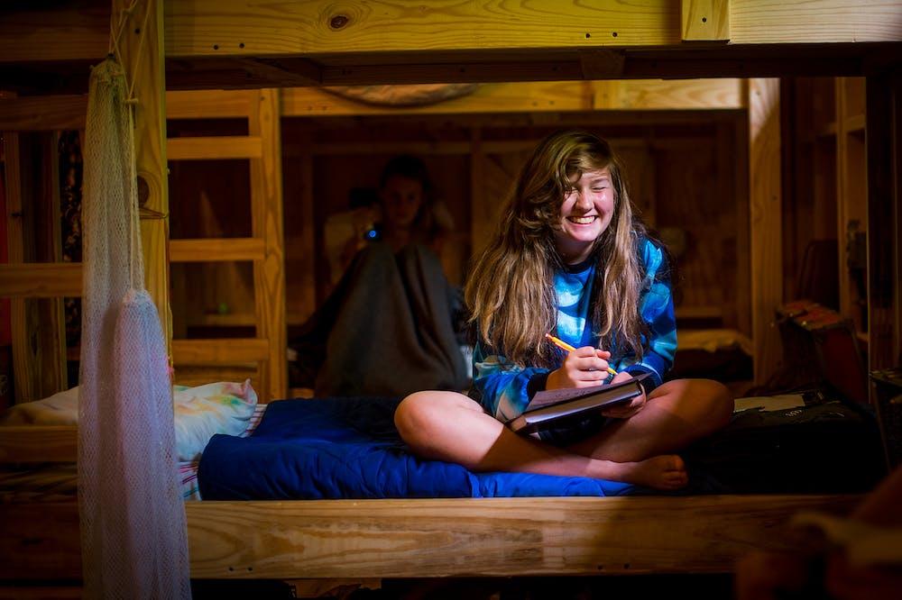 Smiling in the cabin at keystone summer camp for girls in north carolina.jpg?ixlib=rails 2.1
