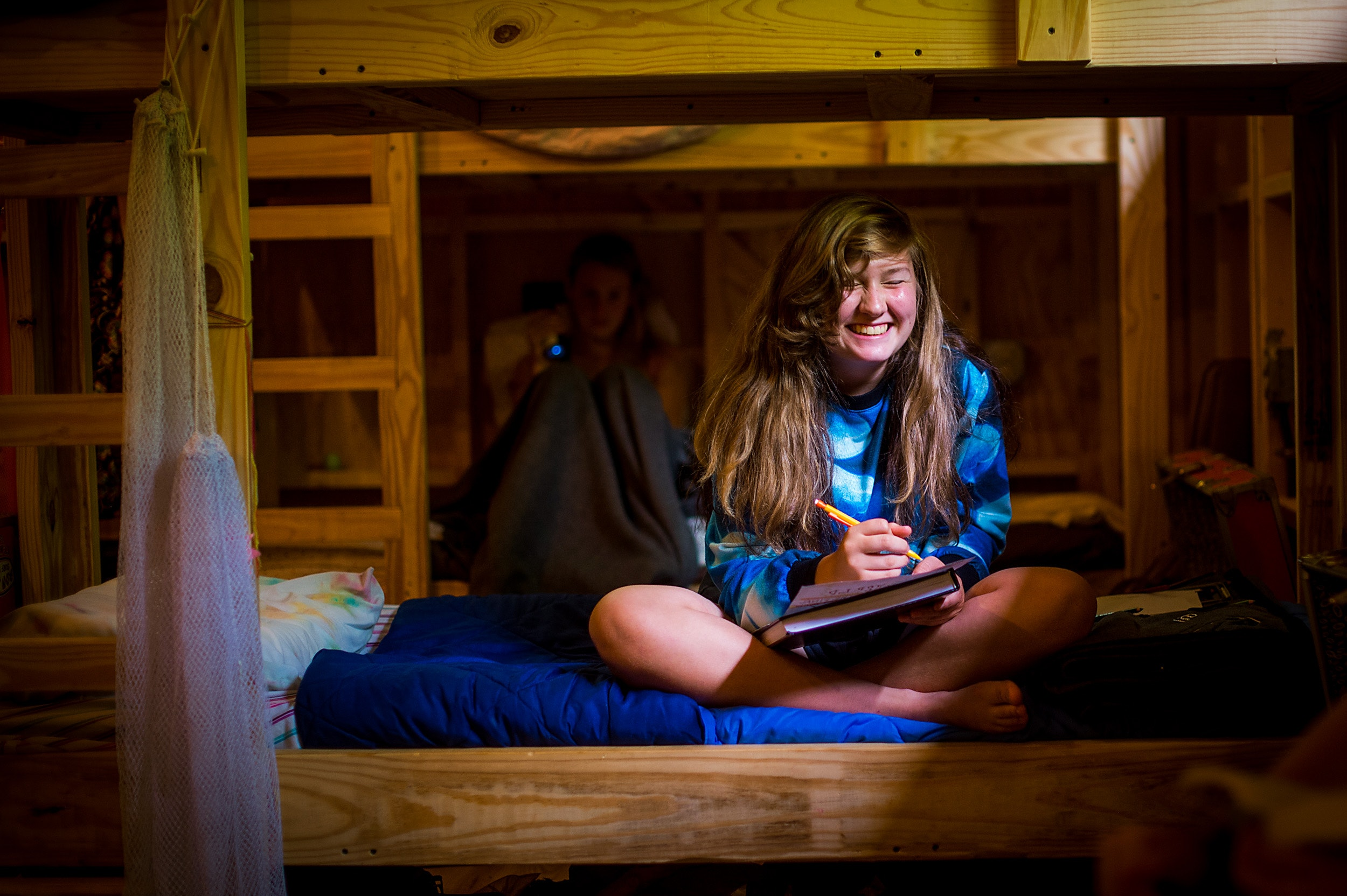 Smiling in the cabin at keystone summer camp for girls in north carolina.jpg?ixlib=rails 2.1