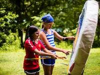 Inspecting the target at keystone summer camp for girls in north carolina.jpg?ixlib=rails 2.1
