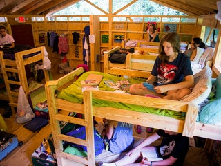 Reading in cabins at keystone summer camp for girls in north carolina.jpg?ixlib=rails 2.1