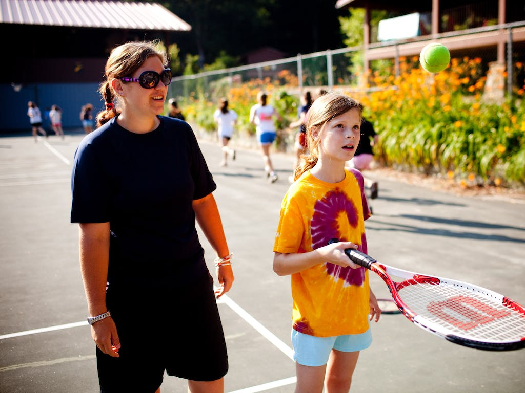 Staff and camper tennis instruction.jpg?ixlib=rails 2.1