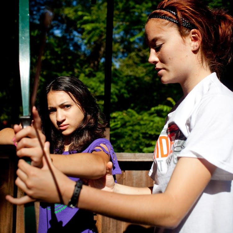 Staff teaching archery at keystone camp for girls in brevard north carolina.jpg?ixlib=rails 2.1