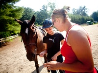 Staff teaching horsemanship at keystone camp for girls in brevard north carolina.jpg?ixlib=rails 2.1