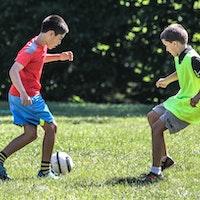 Boys playing soccer outdoors.jpg?ixlib=rails 2.1