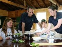 Summer camp counselors cooking.jpg?ixlib=rails 2.1