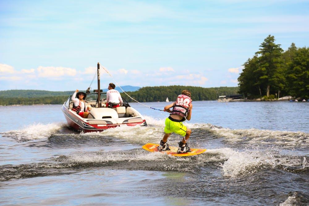 Nh summer camp kids wakeboarding lake.jpg?ixlib=rails 2.1