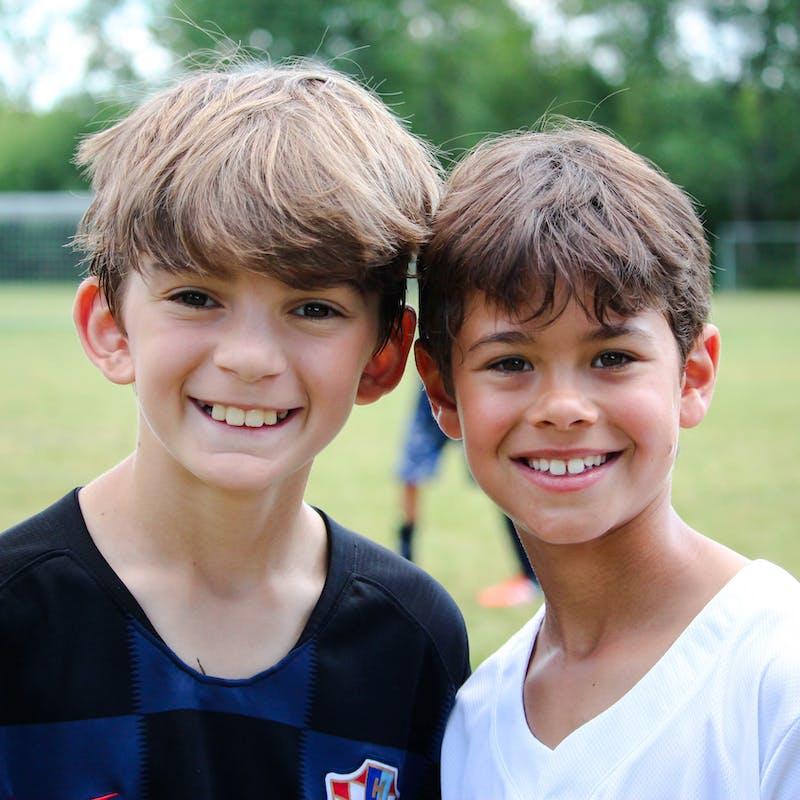 Smiling boys summer camp.jpg?ixlib=rails 2.1