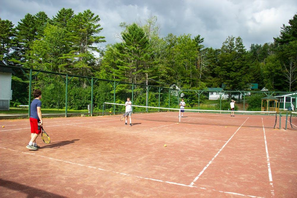 Boys play tennis at camp.jpg?ixlib=rails 2.1