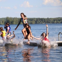 Great camp jobs kippewa equstrian academy summer jobs about jumping water play.jpg?ixlib=rails 2.1