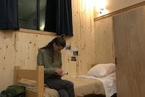 gap  facilities sarah on bed reading night closer.jpg?ixlib=rails 2.1