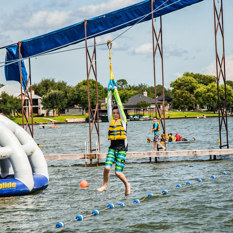 Camp champions central texas summer camp water zip line.jpg?ixlib=rails 2.1