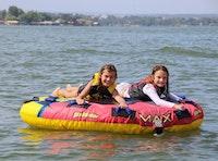 Two girls on floaty.jpeg?ixlib=rails 2.1