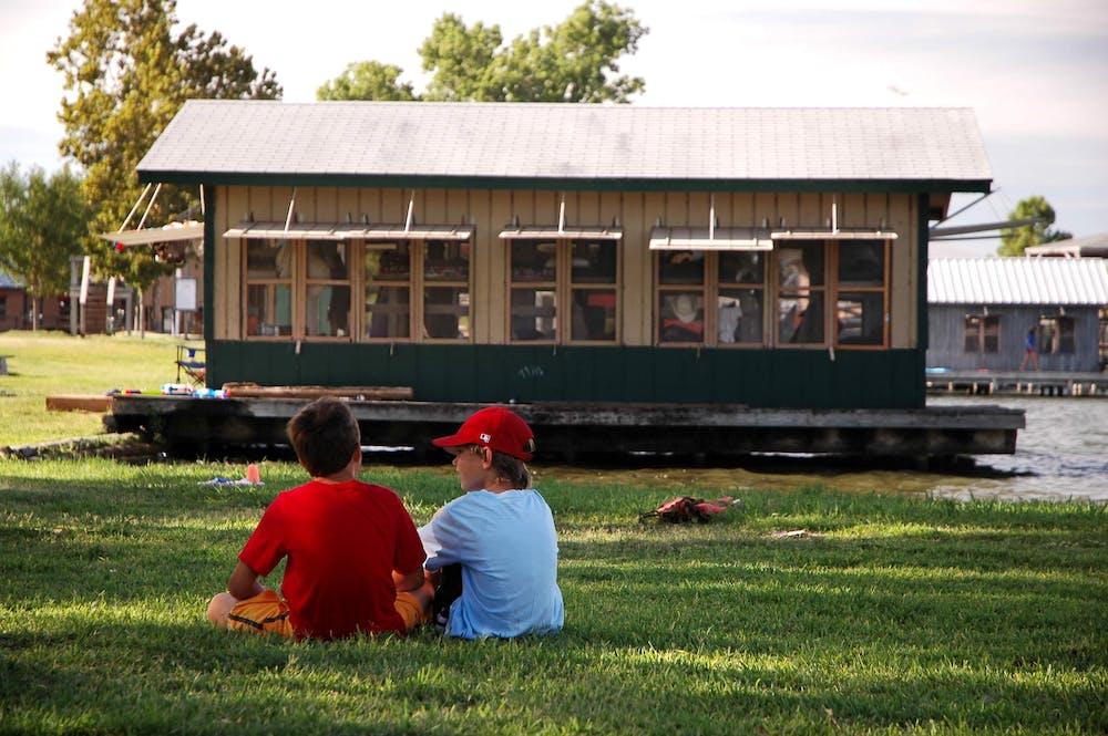 Boys by kayak cabin.jpg?ixlib=rails 2.1