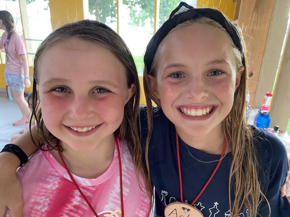 Pair of girls green hall.jpg?ixlib=rails 2.1