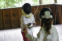 Boy and girl fencing at camp.jpg?ixlib=rails 2.1