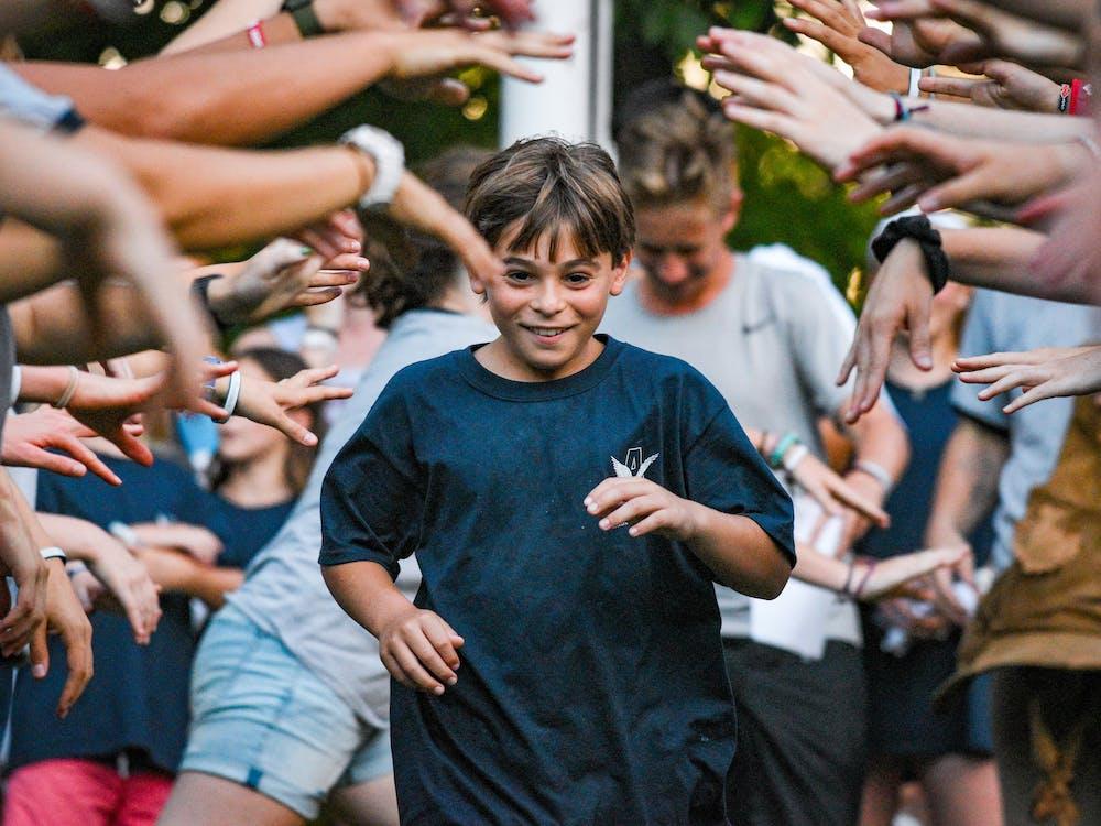 Boy enters camp with cheering.jpg?ixlib=rails 2.1