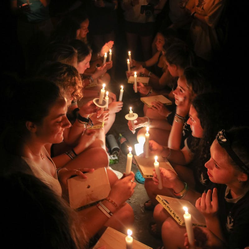Children and counselors with candles.jpg?ixlib=rails 2.1