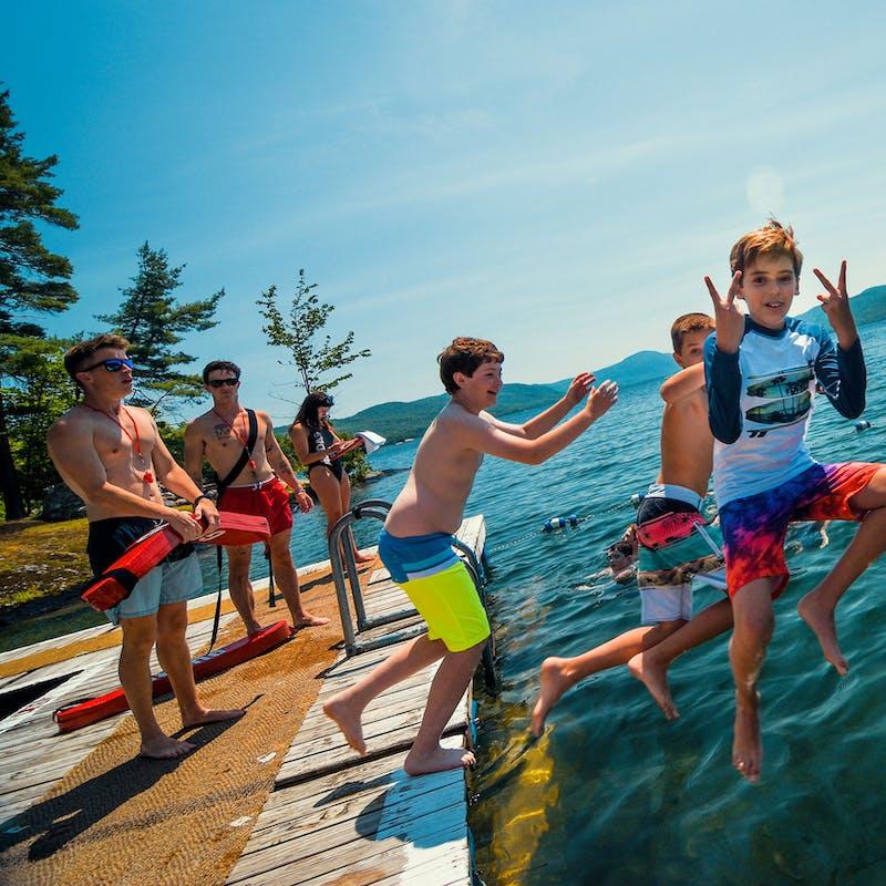 Three boys jumping into lake george.jpg?ixlib=rails 2.1