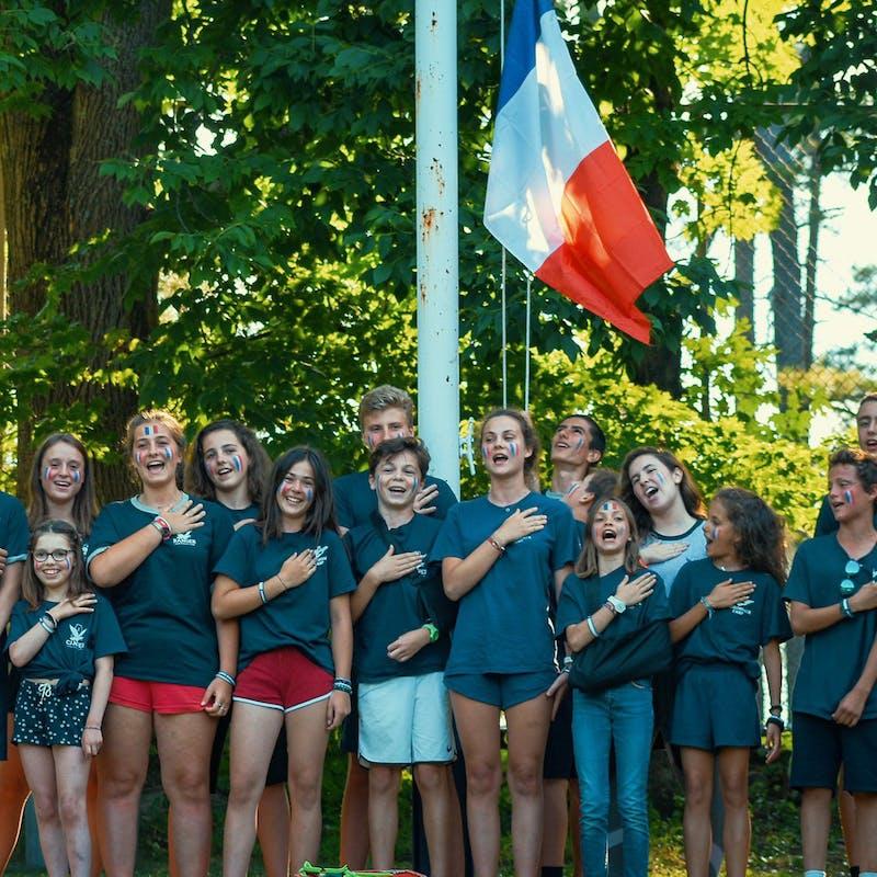 French campers singing.jpg?ixlib=rails 2.1