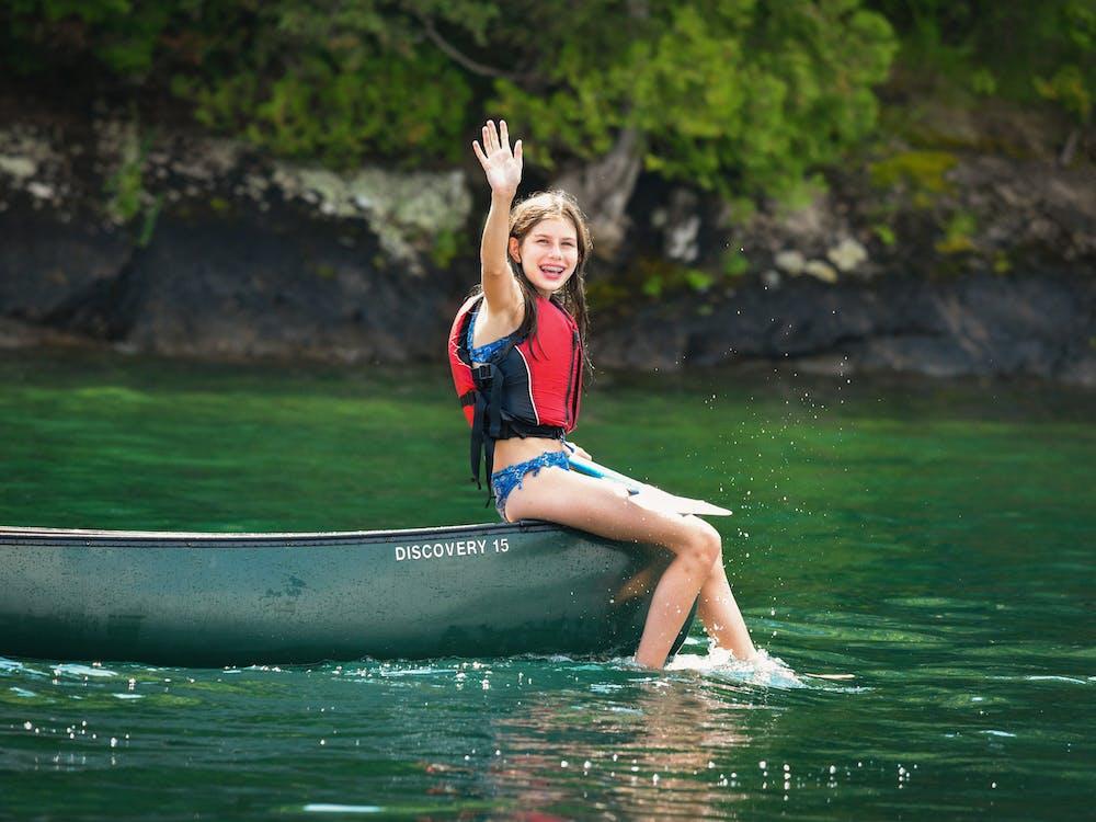Girl setting on a canoe.jpg?ixlib=rails 2.1