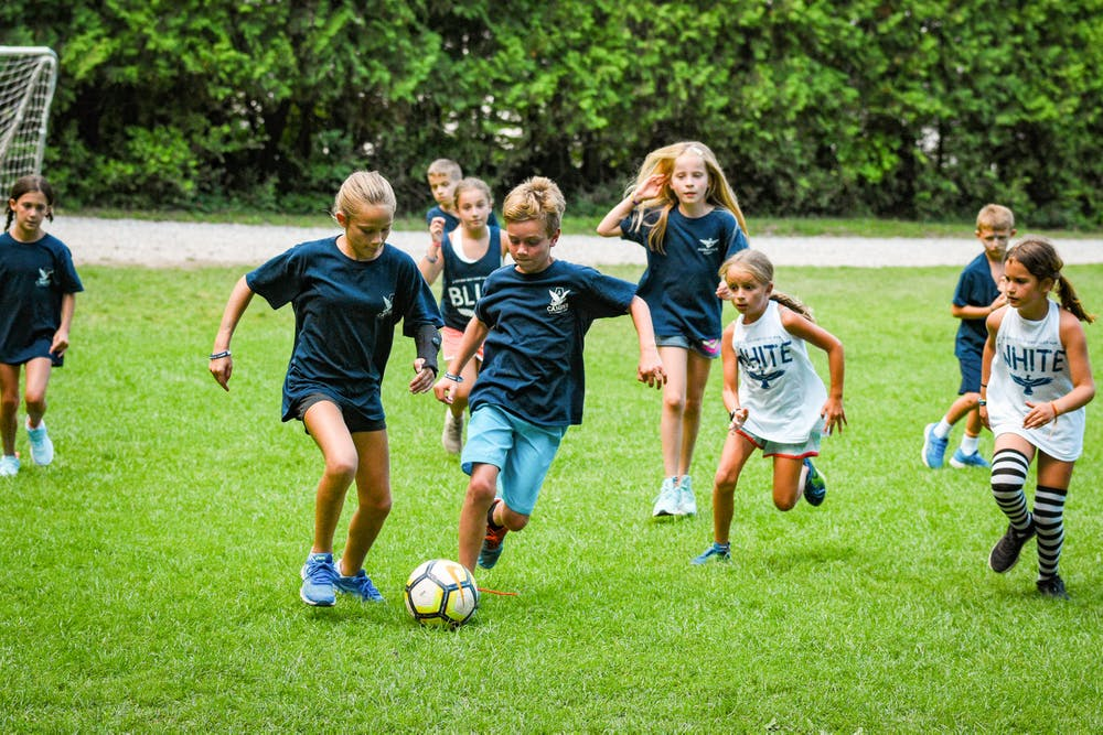 Junior campers play soccer.jpg?ixlib=rails 2.1